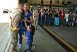 DLM3844  Cpl. Patrick Palmer-Scott gets a big hug from his wife Donna Palmer-Scott and his two...