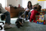 Valerie Fernandez, cq, who lost custody of her three children  spends time with them, Damian, 2,...