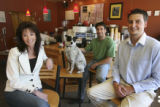 left to right, Loretta Zapp, CEO with Puck the dog and David Boyan, Owner and Jackson Zapp, Sales...