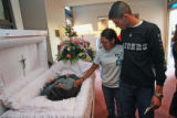 April 3rd, 2007. (from left) Nadia Chairez (cq), passes by the coffin of her sister, Rosemary...