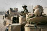 03/25/2005 Denver-Sgt. Samuel Goodwin rides with A team of Bradley Fighting Vehicles, part of the...