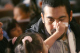 April 4th, 2007. 3 year-old Noelia Puga (cq) wipes the tears off her father's cheek, as Gustavo...