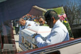 April 4th, 2007. Family and friends of Rosemary Rosales carry her casket to the motorcade that...