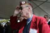 World War II  Prisoner Of War, Robert Derrington, cq, salutes the American flag during the Pledge...