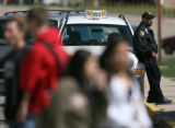 A Jeffco schools Security officer stands outside Arvada High School after the school received...