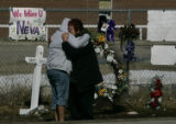 (Red Lake, MN} shot on 3/25/05}) Lorie Applebee (r) hugs her adopted daughter Clarice Applebee. ...
