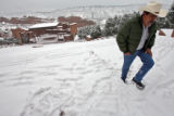 DLM6174  Jose Torres, 50, makes his way up the snowy stairs at the top of the Red Rocks...