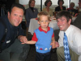 From left, firefighter Chris Shea, William Badger, 2, and Brian Bell. (DAHLIA JEAN WEINSTEIN/ROCKY...