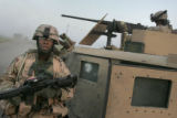 04/10/2005 Iraq-Captain Fred Adams, commanding officer of Lightning Troop, 3/3 ACR, secures his...