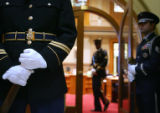 Spec. Austin Faux (cq), left, of the Colorado Army and Air Honor Guard, stands at attention...
