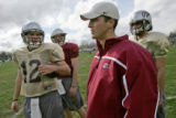 New University of Montana quarterback coach Craig Ochs discuss plays during practice Tuesday...