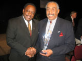 Shaka board member Odell Barry, left, congratulates Service to the Community honoree, Neal...