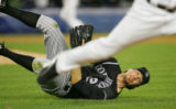 NYEB110 - Colorado Rockies pitcher Ryan Speier watches from the ground as New York Mets' Endy...