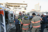 A demolition worker is rescued by Denver Firefighters from the former Rocky Mountain News...