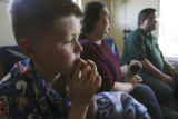 Jerry Monfelt, 10, gets lost in thought as his mom Stephanie Monfelt and Missie and dad Ian White...
