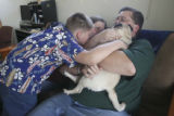 Family farewell; Jerry Monfelt, 10, leans in to kiss Missie while mom Stephanie Monfelt and Ian...