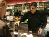 JPM198 Steve Lavezza, the artistic director and co-founder of the Modern Muse Theatre,  tends bar...
