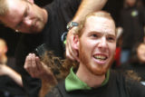Language Arts teacher James Tongue (cq) gets his head shaved by fellow teacher Dan Herr (cq) when...