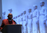 Retired Lt. Col. John Mosley (cq), no age, talks to the audience at a presentation by Tuskegee...