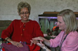 Patient Angie Rodriquez (cq), 60 years old, left, enjoys an oil massage of her hands from Jennifer...