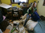 Joy Nameth, 18 sits on her bed at her home and begins doing her homework in Walden, Colo. on...