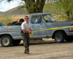 Grand Junction Police Detective Sean Crocker places Tape around a truck where a mans body was...