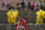 Pilgrims and church visitors watch as Antonio Roybal (cq), 22, portrays Jesus in a re-enactment of...