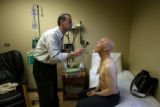 Dr Doug Tippin (cq) - right -, is a cancer patient and is being looked at by MD Peter McSweeney...