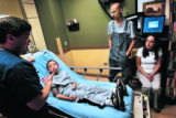 Swedish Medical Center emergency room physician Matt Hart (cq) talks to patient Caleb O'Brien...