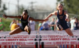 Krystal Thomas, cq, left, of Overland and Brittany Burgeson, cq, of Evergreen run stride for...