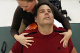 MJM214  Tommy Urbanski (cq) goes through a series of stretches with physical therapist, Audrey...