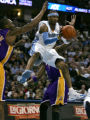 Denver Nuggets guard Allen Iverson looks to pass the ball in the first quarter of play being...