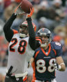 In the first quarter, Bengals' Dexter Jackson, left, intercepts a pass to Denver Broncos' Tony...