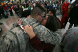 (DLM2257) -   Army Sgt. Jose Torres of Englewood kisses his wife Stephanie after flying in during...