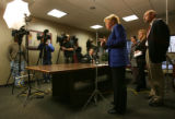 MJM056 Arapahoe County District Attorney, Carol Chambers, center, holds a press conference with...