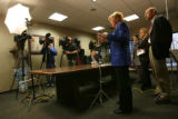 MJM061 Arapahoe County District Attorney, Carol Chambers, center, holds a press conference with...
