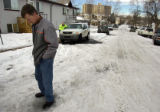 Denver Mayor John Hickenlooper looks down at the snow covered side street near Utica Street and...