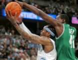 Denver Nuggets guard Allen Iverson drives to the basket being defended by Boston Celtics' Tony...