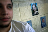 MJM213 Denver County Jail inmate, Louis Bueno (cq) on his bunk bed beside photos of his wife,...