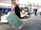FLPAP604 - A tally board is carried away after Briny Breezes residents voted to sell the trailer...