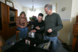 Mother Debra Anderson, left, brother Kyle Anderson, center, and father Rick Anderson, right, look...