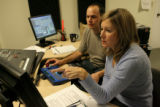 Helen Forster, cq,  of eTown in Boulder, works with Ryan White, cq, as they edit a radio show,...