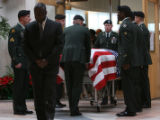 MJM300 Pastor Mel Waters, left, walks out of a memorial service in front of the coffin of PFC Seth...