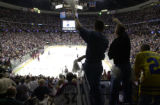 Photo By PATRICK DAVISON/Rocky Mountain News FANS CELEBRATE Saturday night IN THE THIRD PERIOD...