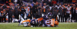 In the fourth quarter, the Denver Broncos John Lynch (#47, S) and Karl Paymah (#41, CB) tackle the...