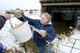 Jacy Lantz, cq, 16 of Watkins is handed feed by her mother Brenda Lantz, cq, (left), Thursday Dec....