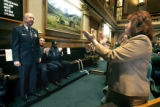 (DENVER, Co. - SHOT 3/28/2005) Rep. Cheri Jahn (right), D-Wheatridge applauds as Brig. Gen. Emil...