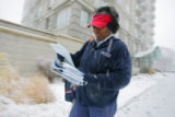 U.S. Postal Carrier Michelle Blackmon (cq) delivers mail along Pennsylvania St. near 2nd Ave. on...
