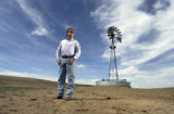 (Adams County, CO., March 28, 2005) Brian Downing stands near an old wind mill used to pump water...