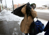 Craig Fuller (cq), 40, lifts his bag of clothes over his shoulder before entering the Denver...